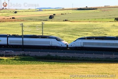 AVE 5193 Alicante - Madrid Atocha -- Trainsets 06 and 07 from the S-100 series travelling at 200 km/h, near Albacete.